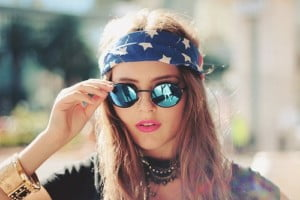 girl in blue shades and flag head scarf