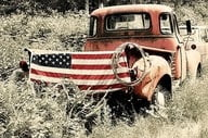 American flag tailgate old red truck